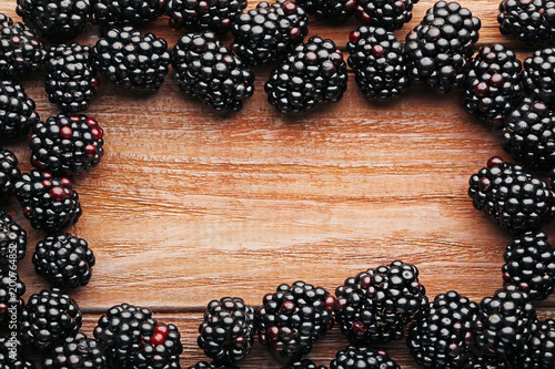 Foto op Canvas Natuur Ripe and sweet blackberries on brown wooden table