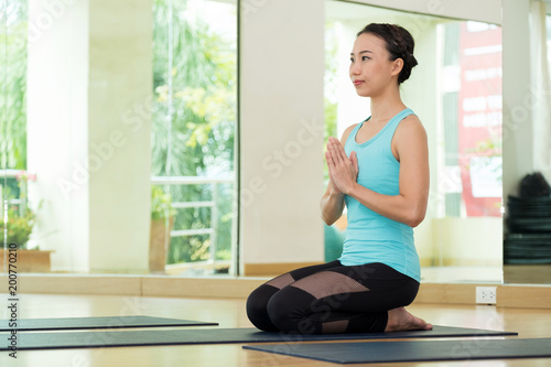 Foto op Aluminium School de yoga Young asian woman practicing yoga meditation, healthy lifestyle, wellness, well being