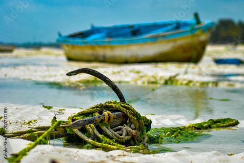 Fotobehang Zanzibar Boat behind anchor