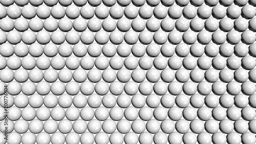 Białe błyszczące sfery tworzące wzór tła. Komputer wytwarzał 3D ilustrację.