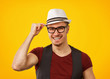 Cheerful hipster in hat smiling at camera
