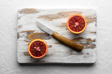 Orange pieces on wooden board closeup. Healthy diet vitamin concept. Food photography