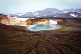 Acid hot lake in the geothermal valley Leirhnjukur, near Krafla volcano, Iceland, Europe.