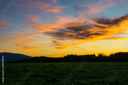 In de dag Honing Germany, Awesome cloudscape, dramatic orange sky over black forest nature landscape