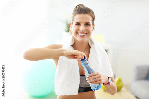 Fridge magnet Woman doing fitness exercises at home