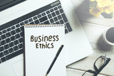 business ethics text on notepad on keyboard - 200799481