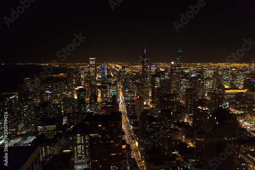 Poster Chicago Chicago Skyline aerial view skyscrapers by the beach, night shot
