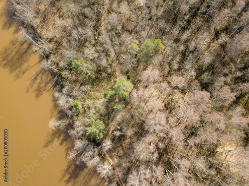 drone image. aerial view of forest river in spring. Gauja, Latvia - 200805030
