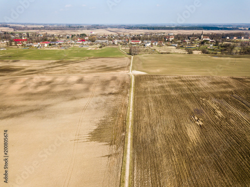 Foto op Canvas Beige drone image. aerial view of wet cultivated agriculture fields near Jaunpils in Latvia