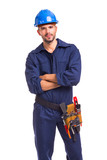 Portrait of a serious young worker standing with arms crossed on white background