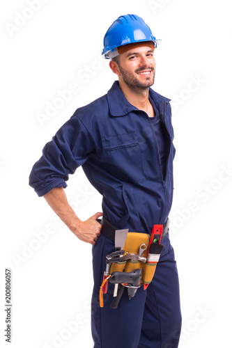 Portrait of a smiling young worker standing on white background