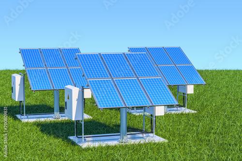 Koncepcja odnawialnych źródeł energii. Panel słoneczny w zielonej trawie przeciw niebieskiemu niebu, 3d rendering