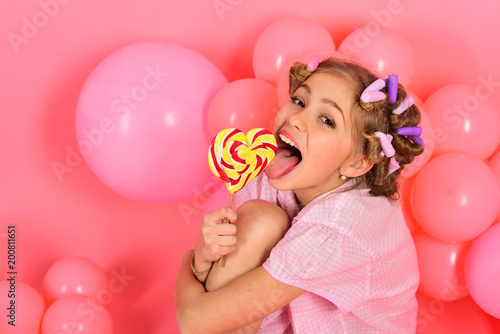 Little girl with candy lollipop.