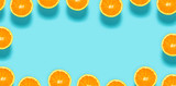 Fresh orange halves on a blue background - 200831210