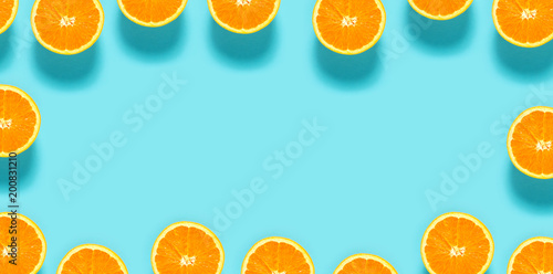 Fresh orange halves on a blue background - 200831210