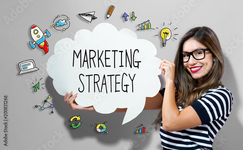 Marketing Strategy text with young woman holding a speech bubble