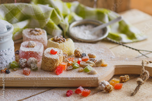 Foto Murales East sweets with fruits, nuts and sugar powder