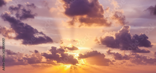 Bright colorful sunset sky, clouds and sun rays, natural background and texture