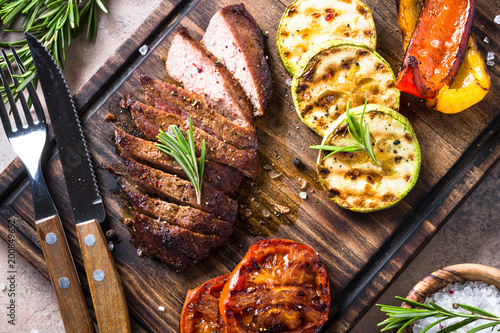 Barbecue dish. Beef steak and grilled vegetables top view.