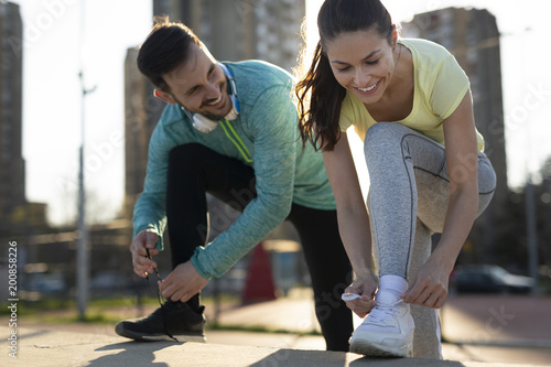 Athletic couple jogging together