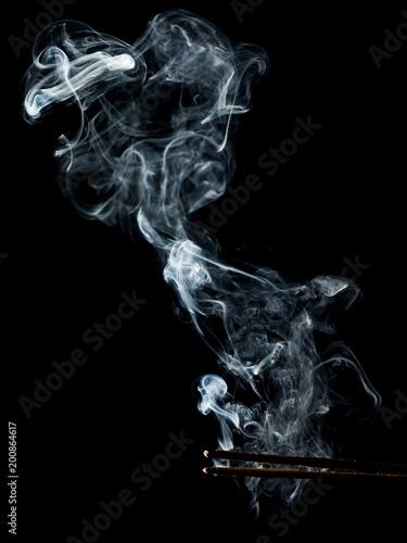 fumo con bacchette
