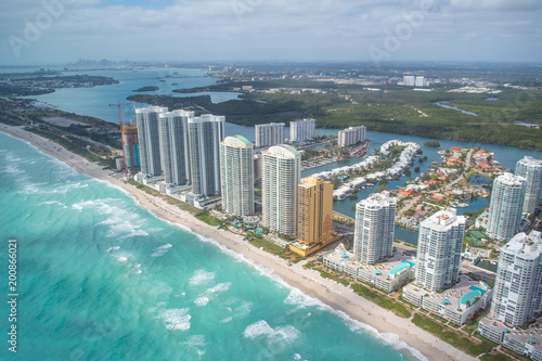 Foto Murales North Miami Beach buildings as seen from helicopter, Florida. Skyscrapers along the ocean, aerial view.