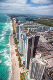 North Miami Beach as seen from helicopter. Skyscrapers along the ocean, aerial view