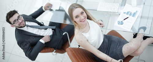 business people sitting at office desk in office. top view