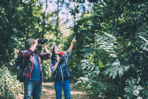 Young with Binocular onwith outdoor forest on background Travel concept.