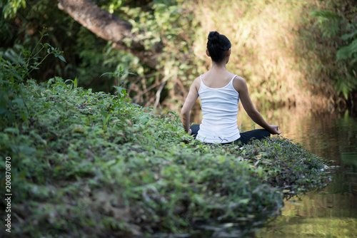 woman playing yoga garden field weekend holiday lifestyle park outdoor nature background.