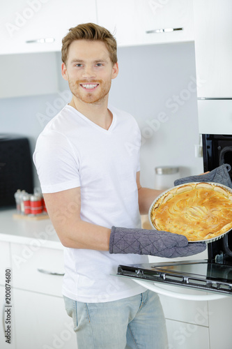 Man showing tart he has made