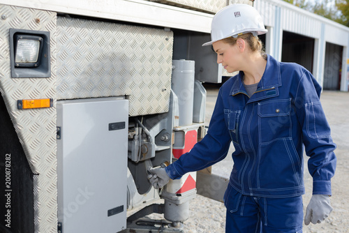 woman operating construction site machine