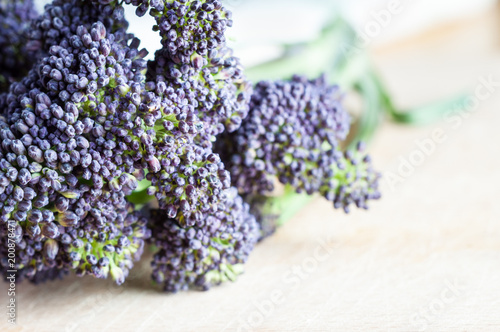 Purple Sprouting Broccoli on Wooden Table Closeup