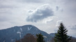 huge rockface mountain with clouds in the background - 200879841