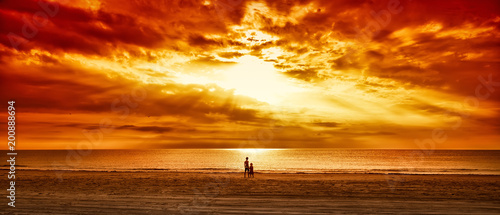 children standing on a beach - 200888694
