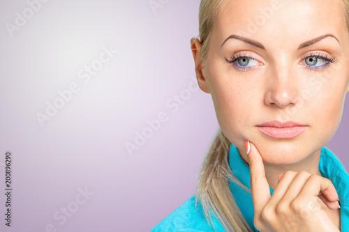 Pensive thoughtful blonde woman portrait