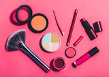 Multiple beauty tools on a pink background