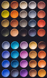 Colorful eyeshadow set on a black background.