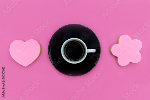 Coffee cup + saucer with love heart on pink background