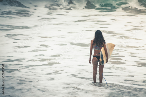 Keuken foto achterwand Bali Surfer with surfboard gonna to surf spot, walk near beach.