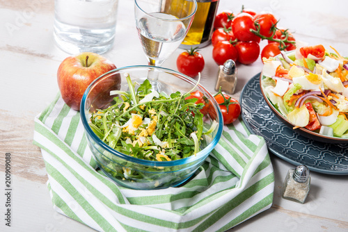 dandelion salad in a glass bowl - 200909088