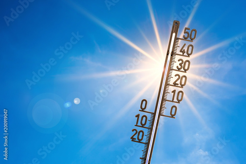 canvas print picture Summer background, bright sun with thermometer
