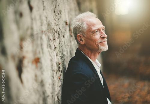 Foto Murales Portrait of handsome mature man, light effect