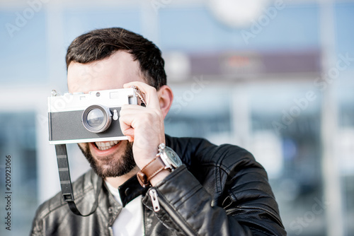 Man with photo camera outdoors