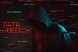 Data breach concept with faceless hooded male person