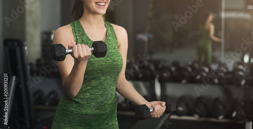 Aluminium Fitness Fitness woman with dumbbells at gym