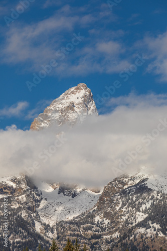 Clouds in the Snow Capped Tetons in Autumn