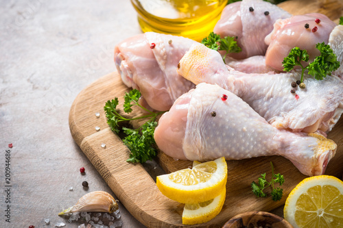 Raw Chicken drumsticks and cooking ingredients.