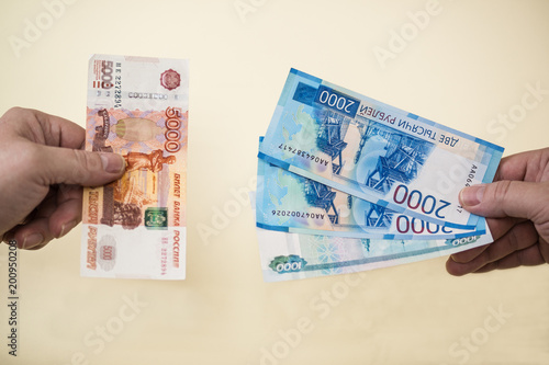 Exchange of five thousand Russian banknotes for smaller money in two and one thousand rubles