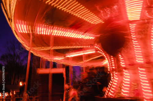 beautiful bright carousel in amusement park,night
